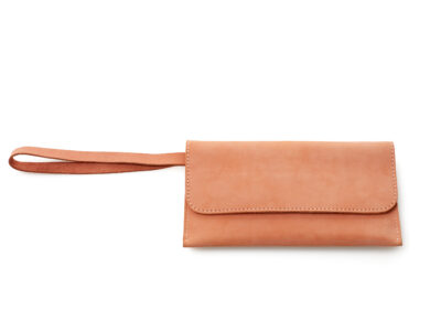 nasire travel pouch in red ochre nubuck leather